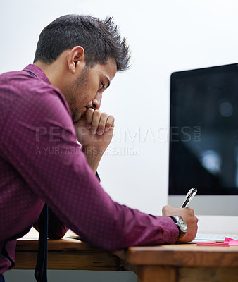 Buy stock photo Cropped shot of a businessman working at his desk