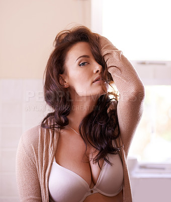 Buy stock photo Shot of a gorgeous young woman posing seductively at home