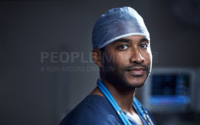 Buy stock photo Portrait of a confident young surgeon standing in an operating room