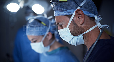 Buy stock photo Cropped shot of surgeons in an operating room