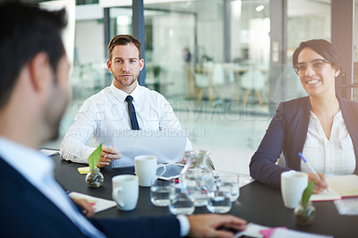 Buy stock photo Cropped shot of a group of colleagues meeting in the boardroom