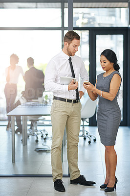 Buy stock photo Full length shot of two colleagues meeting outside the boardroom before their presentation