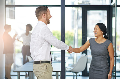 Buy stock photo Cropped shot of two colleagues shaking hands outside the boardroom before their presentation