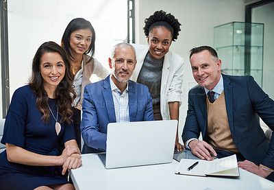 Buy stock photo Portrait of a group of businesspeople working together on a laptop in a modern office