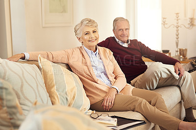 Buy stock photo Shot of a senior couple spending time together in the living room
