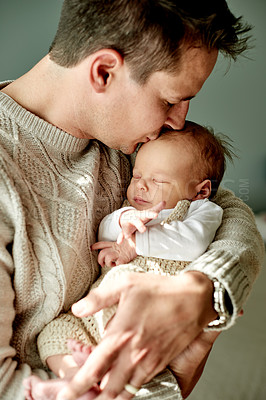 Buy stock photo Shot of a father spending time with his newborn baby