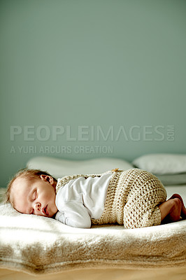 Buy stock photo Shot of an adorable baby boy taking a nap