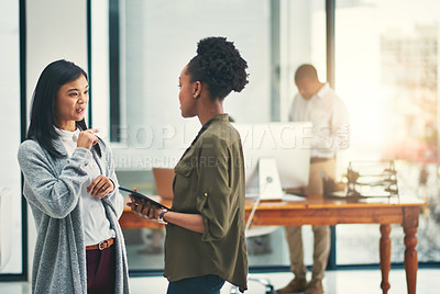 Buy stock photo Cropped shot of young creatives having a discussion in an office