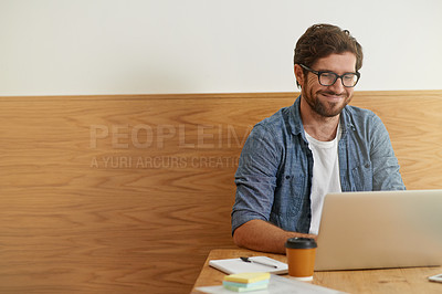 Buy stock photo Cropped shot of a young man working on his laptop