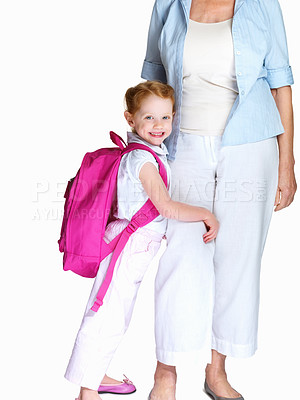 Buy stock photo Portrait of a happy little girl with bagpack embracing her grandmother