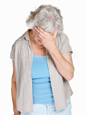 Buy stock photo Portrait of a sad mature woman holding her head isolated against white