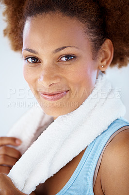 Buy stock photo Closeup portrait of a happy woman with a towel around her neck after working out