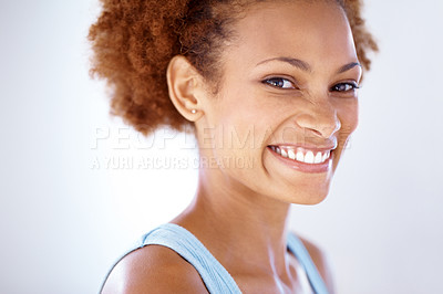 Buy stock photo Closeup portrait of a beautiful young female smiling against grey background