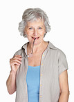 Happy senior woman holding glasses isolated against white