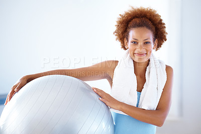 Buy stock photo Portrait of a pretty young woman smiling happily with her pilates ball alongside copyspace