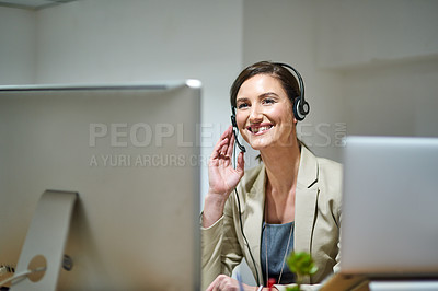 Buy stock photo Shot of a professional woman using a computer and headset at her desk