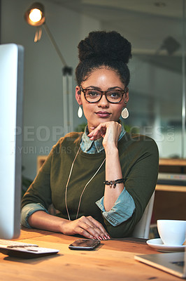 Buy stock photo Portrait of an attractive young woman working on her computer in the office