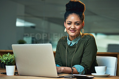 Buy stock photo Portrait of an attractive young woman working on her laptop in the office