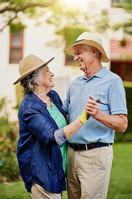Buy stock photo Cropped shot of an affectionate senior couple dancing in their backyard