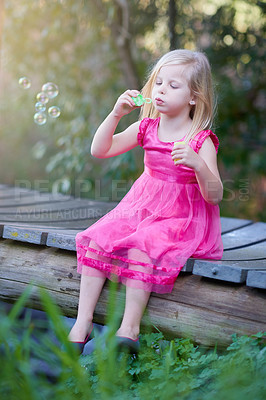 Buy stock photo Shot of a cute little girl playing outside