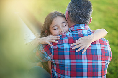 Buy stock photo Shot of a happy little girl hugging her father at home