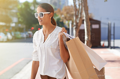 Buy stock photo Shot of a young woman on a shopping spree in the city