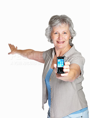 Buy stock photo Portrait of a smiling senior woman displaying her mobile isolated against white
