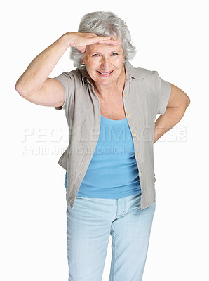 Buy stock photo Portrait of a Smiling senior woman shielding her eyes isolated against white