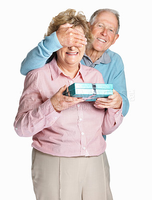 Buy stock photo Portrait of a happy mature man covering senior woman's eyes to surprise her with a gift