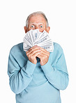 Surprised mature man holding dollars isolated against white