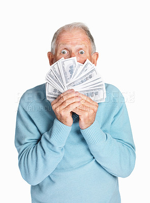 Buy stock photo Portrait of a surprised mature man holding dollars isolated against white