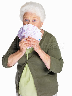 Buy stock photo Portrait of an elderly woman holding currency notes on white background