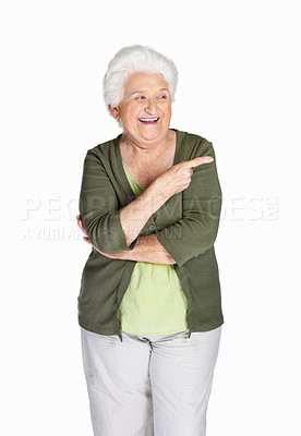 Buy stock photo Portrait of a happy mature woman pointing at something interesting against white