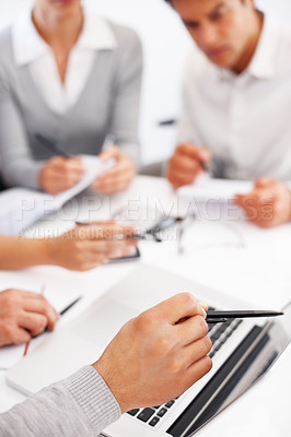 Buy stock photo Cropped view of hand explaining project on laptop in a business meeting