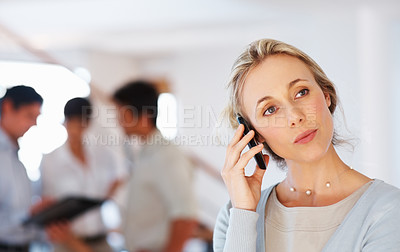 Buy stock photo Business woman using cellphone with colleagues in blurred background