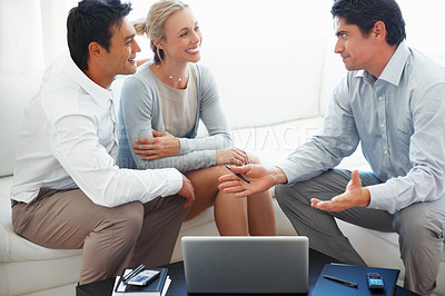 Buy stock photo Happy business couple in conversation with consultant