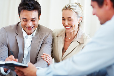 Buy stock photo Focus on happy middle aged couple talking to financial advisor