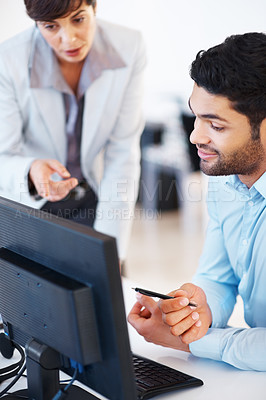 Buy stock photo Executives discussing business matters on computer