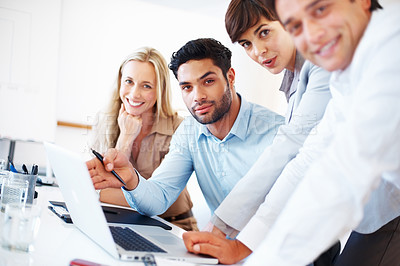 Buy stock photo Portrait of business team working together on laptop