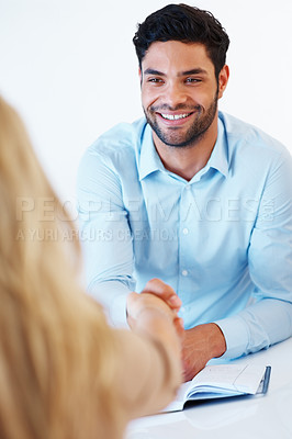 Buy stock photo Handsome business man shaking hands with female colleague