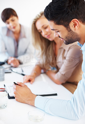 Buy stock photo Business man discussing with colleagues during meeting