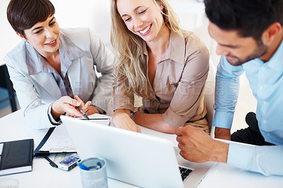 Buy stock photo Business colleagues discussing project on laptop during meeting
