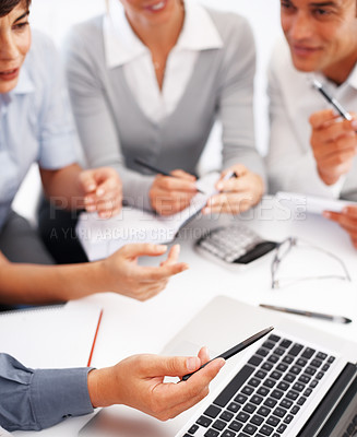 Buy stock photo Cropped image of business people discussing project on laptop during meeting