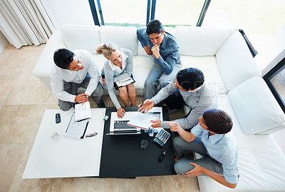 Buy stock photo High angle view of male executive discussing project with his colleagues