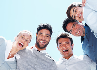 Buy stock photo Closeup of successful business people in a huddle smiling together - copyspace