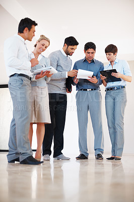 Buy stock photo Full length of business people standing together and discussing work