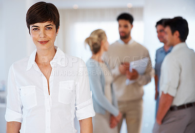 Buy stock photo Portrait of attractive business woman with colleagues discussing in background