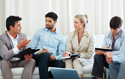 Buy stock photo Business man discussing project during meeting with colleagues taking notes