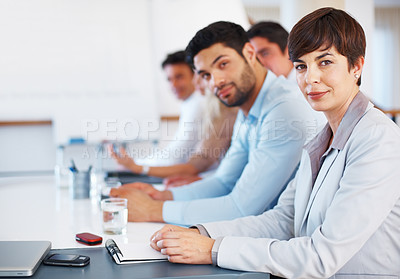 Buy stock photo Portrait of attractive business woman sitting at table with colleagues during presentation