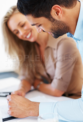 Buy stock photo Smiling business colleagues sitting at table and discussing